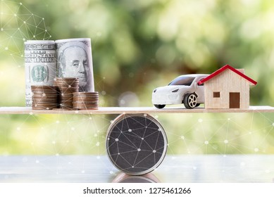 Business real estate investment concept : Wooden home, car with stack of money coins US dollar,JPY on wood round box balance green background. Savings plans housing, loan money. Investing is risky.