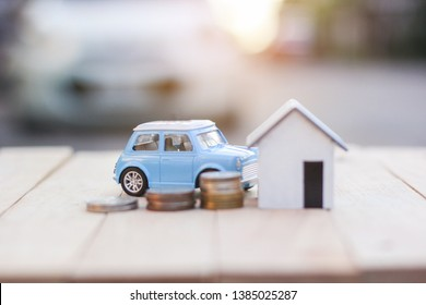 Business real estate investment concept : Wooden home, car with stack of money coins  on abstract background. Savings plans housing, loan money