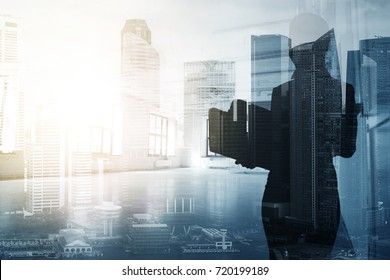 business, real estate and people concept - businesswoman or secretary over city background