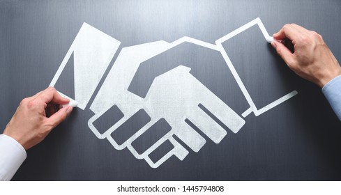 Business relationship concept. Strategy of successful deal. Businessmen drawing handshake illustration on chalkboard.