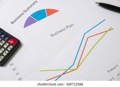 Business report or Financial paper with pen and calculator in business concept