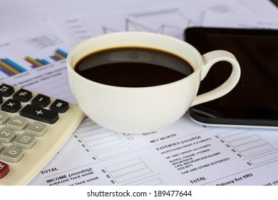 Business report with pen, coffee and laptop computer