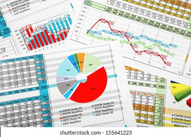 Business Reports in Multicolor Charts and Diagrams