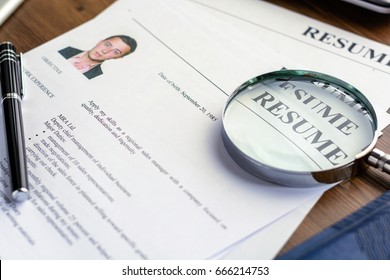 Business resume with man portrait on desk with business accessories