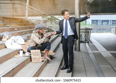 a business rich man take picture selfie with a poor man or homeless or beggar sitting beside walkway or step of stair and text please help