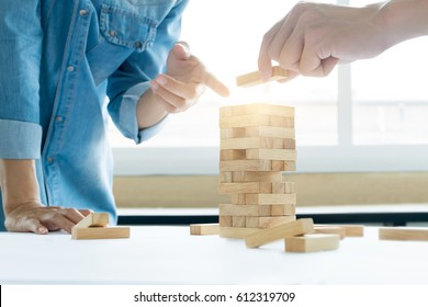 business risk and strategy planing, hands of people placing wooden block on a tower