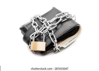 Business safety and finance protection concept - metal chain link with locked padlock on leather wallet full of dollar currency money white isolated