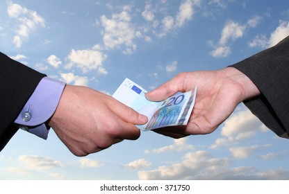 business scene: one person giving money to another