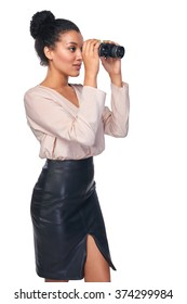 Business search concept. Side view of business woman looking through binoculars at blank copy space, isolated over white