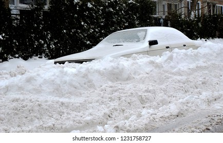 In the business of selling a snow blower, or heavy duty shovel, here is the photo for you.  Car buried after the street plow has passed