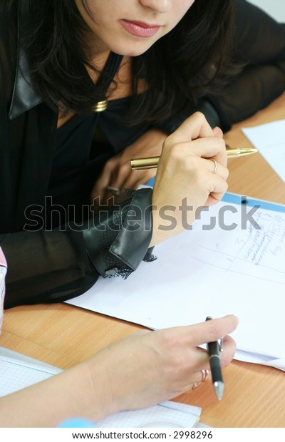 Business seminar situation, students with papers