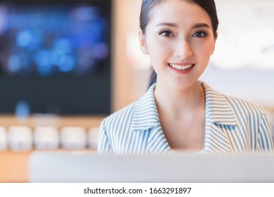 business service support active asian female staff happiness and pleasure to takecare solve problem for client, asian female use laptop and smartphone help and service department