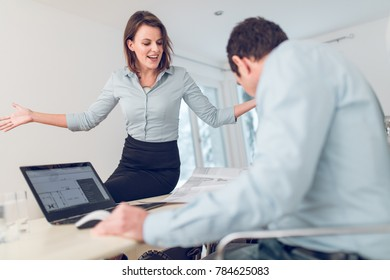 business setting between young female coworker and her boss, coleague