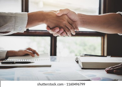 Business shaking hands after discussing good deal of Trading to sign agreement and become a business partner, contract for both companies, Successful businessman handshake.