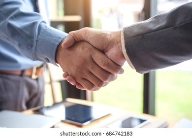 Business shaking hands. Business executives to congratulate the joint.