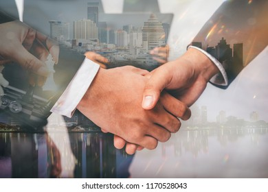 Business shaking handsafter discussing good of partner over the photo blurred of group Teamwork are discussing in modern workplace,Finishing up a meeting.