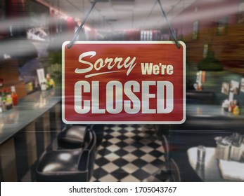 A business sign that says 'Sorry, We're Closed' on cafe/restaurant window.