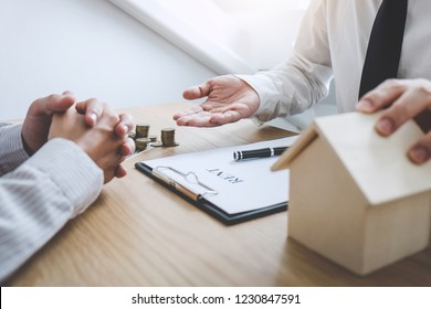 Business Signing a Contract Buy - sell house, insurance agent analyzing about home investment loan Real Estate, Concept mortgage loan approval.