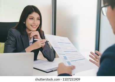 Business situation, job interview concept. Confident businessman in a job interview with a corporate personnel manager.