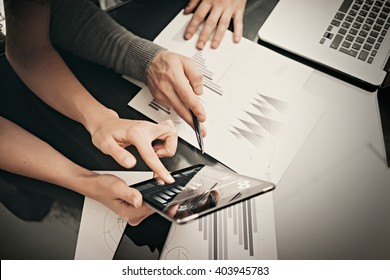 Business situation,meeting of financial managers.Photo woman showing marketing reports tablet.Modern laptop on table. Working process office, discussion startup.Horizontal. Film effect