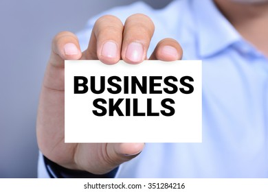 BUSINESS SKILLS message on the card shown by a man