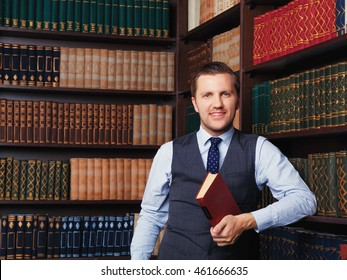 Business smart hipster lawyer man near bookcase