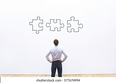 business solution concept, businessman looking at the pieces of puzzle