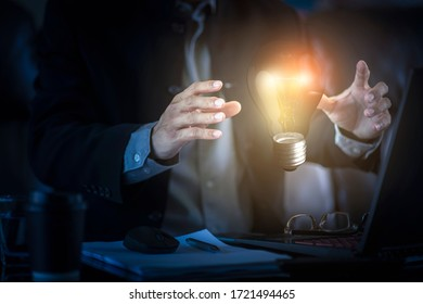 Business solution and innovation concept. Businessman holding  lightbulb  of new ideas and creativity.