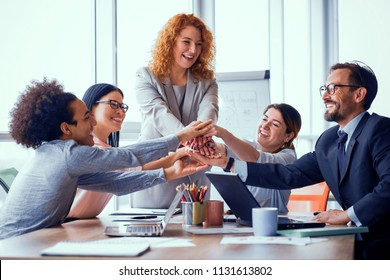 Business solution ready. Business team holding hands together. Successful work is done. Toned concept.