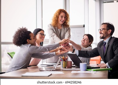 Business solution ready. Business team holding hands together. Successful work is done.