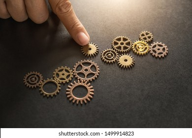 Business Solutions for Success and Strategy. Businessman hands connect the gears with a puzzle. Fulfill and fix the problem of incomplete teamwork.