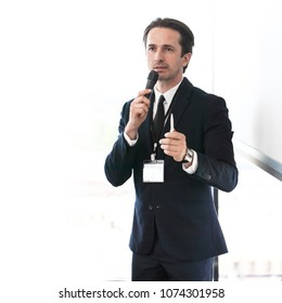 Business speaker giving a presentation to audience