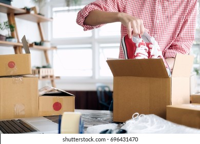 Business Start up SME concept. Young startup entrepreneur small business owner working at home, packaging and delivery situation.