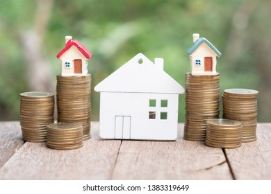 Business Startup. mortgage and real estate investment. mini house on coin stack