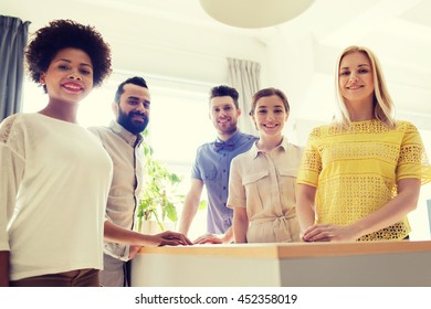 business, startup and office concept - happy business team in office