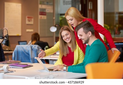 business, startup and people concept - happy creative team talking in modern office