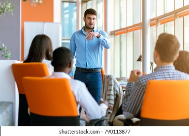 business, startup, presentation, strategy and people concept - man making presentation to creative team at office
