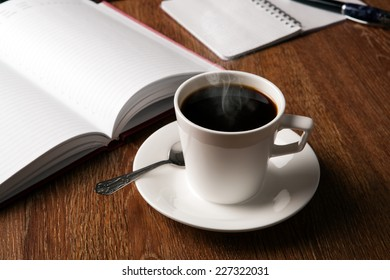 business still life with cup of black coffee on desktop