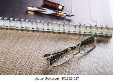 business still life pens and diaries