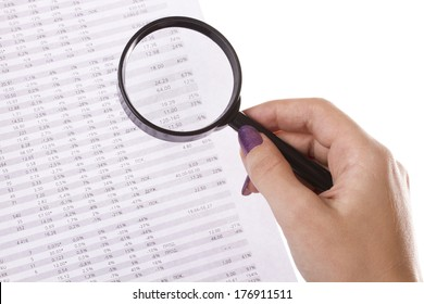 Business still-life charts, magnifier in hands