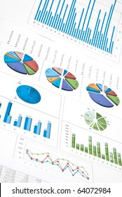 Business still-life with diagrams, charts and numbers. Vertical shot