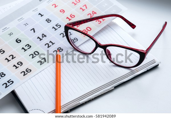Business still-life, recording ideas, glasses, calendar and notes