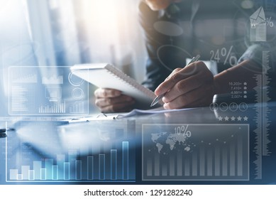 Business strategy analysis concept. Asian businessman working on laptop computer at modern office with financial graph diagram, business data computer dashboard on virtual screen