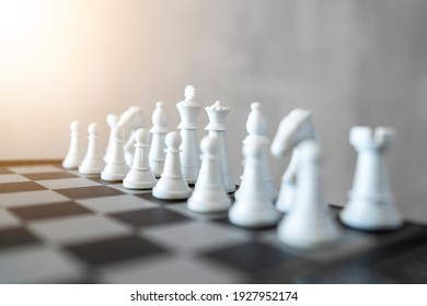 Business strategy. Chess board game with black and white pieces. Enterprise competition plan, power, leadership and team work, intelligence, smart thinking and make a move. High Resolution