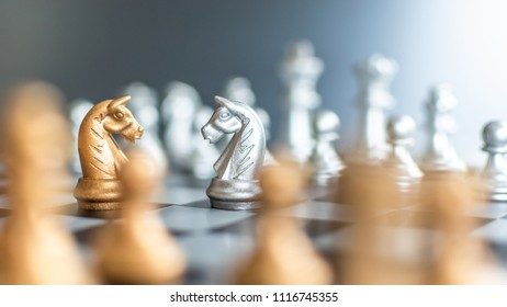 Business strategy competition, strategic planning for winning success and human resource management concept with chess figure knight leader on chessboard facing defender on opposite side