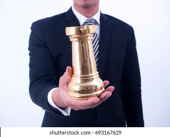 Business strategy and leadership concept - Businessman holds a chess symbol of the leader.