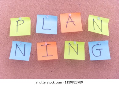 Business strategy and marketing concept, planning word alphabet reminder on color sticky notes pinned on a cork bulletin board