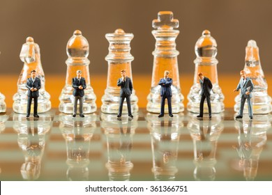 Business strategy and teamwork concept with chess game on chessboard.