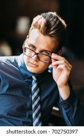 Business stylish young man in glasses