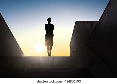 business, success, achievement and people concept - silhouette of woman standing on stairs over sun light background